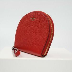 kate spade Bags - JACKSON HALF MOON WRISTLET CLUTCH BAG LEATHER